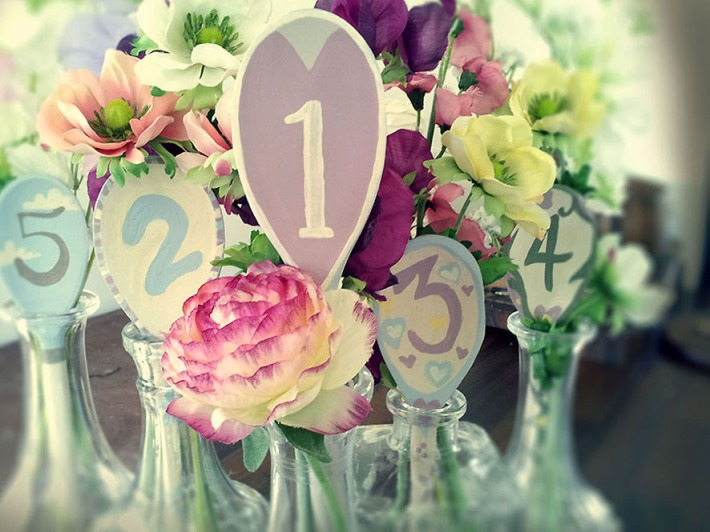 Mismatched Vases for Floral Table Numbers